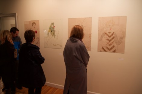 Vistors examine illustrations themed around various saints