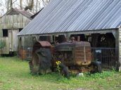 Antique tractor by the tractor barn