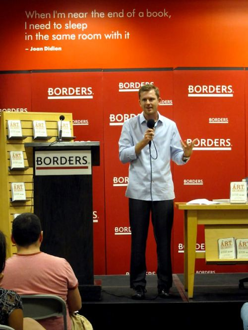 Photo of Chris speaking to the crowd at his book launch