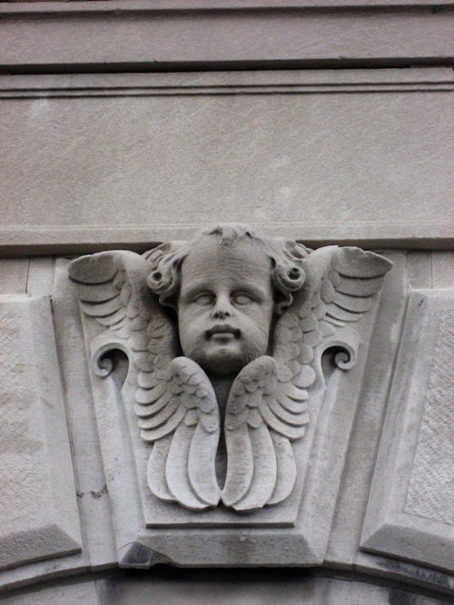 Photo of angel on building frieze in NY City, taken by Joana Miranda