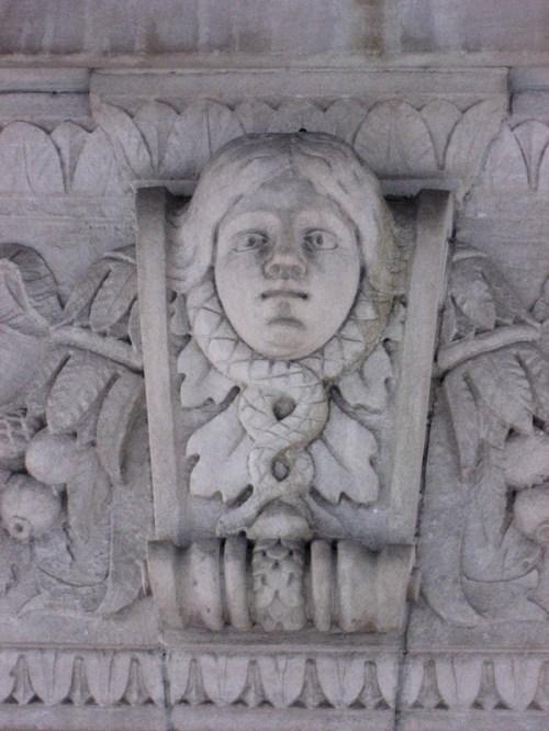 Carving of woman with serpents on NY City building frieze, photo taken by Joana Miranda