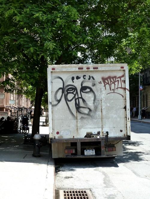 Photo of graffiti face on the back of a truck, taken by Joana Miranda