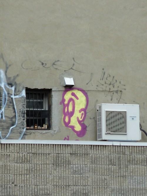 Photo of sad cartoon graffiti face, taken by Joana Miranda