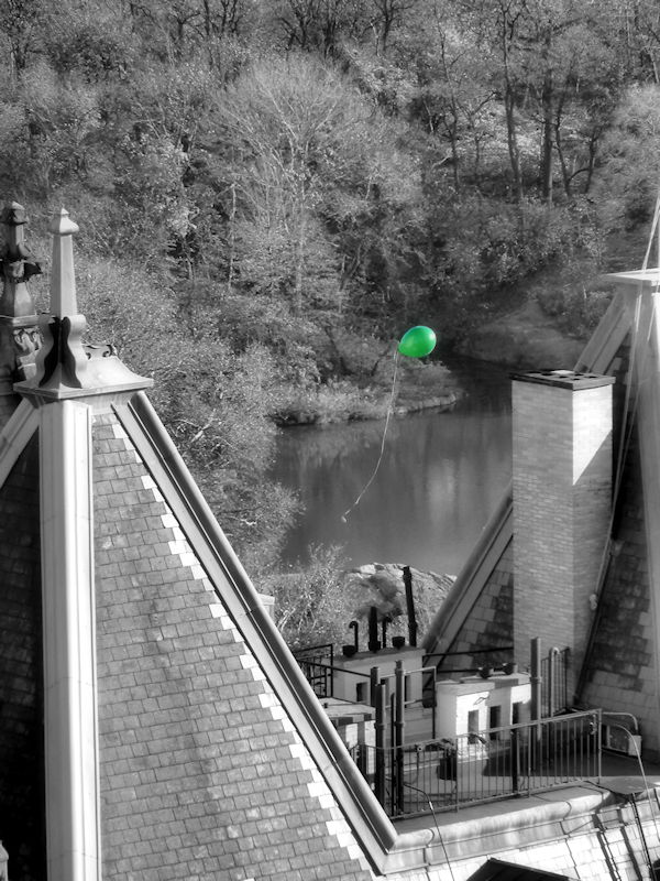 Black and white photo of Dakota apartment building with green balloon taken by Joana Miranda
