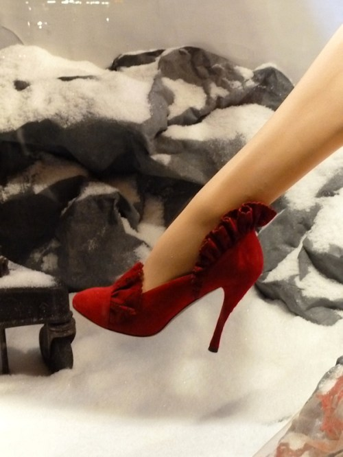 Photo of pretty red ruffled pumps at 2011 Bergdorf Goodman Christmas window display, taken by Joana Miranda