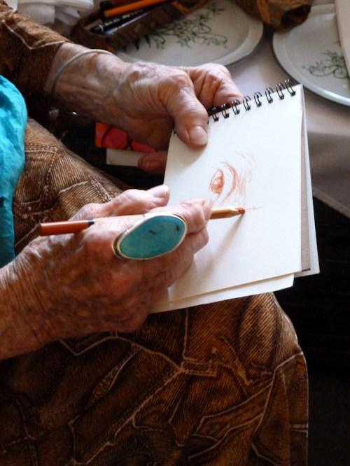 Photo of Ilona Royce-Smithkin's hands as she sketches, taken by Joana Miranda