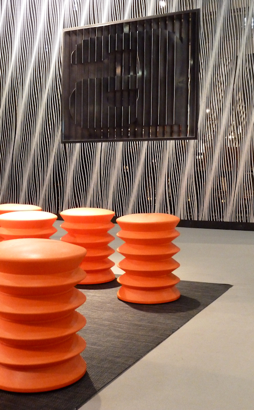 Photo of orange sprongy stools, taken by Joana Miranda