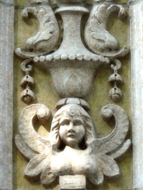 Photo of frieze of angel on the side of a New York City Deco building, taken by Joana Miranda