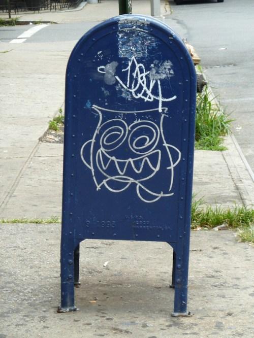 "Photo of US mailbox ""decorated"" with graffiti, taken by Joana Miranda"