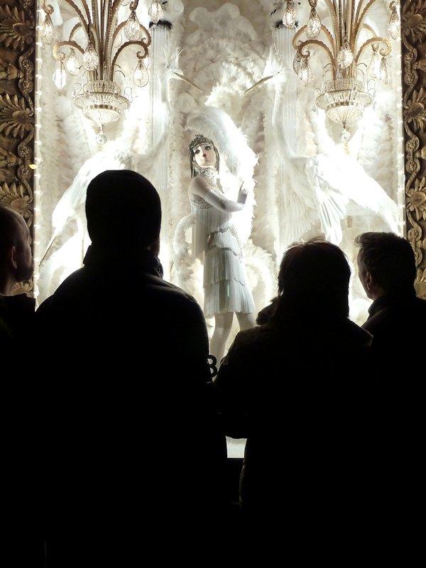 Photo of spectators looking at the 2012 Bergdorf Goodman Holiday Window display