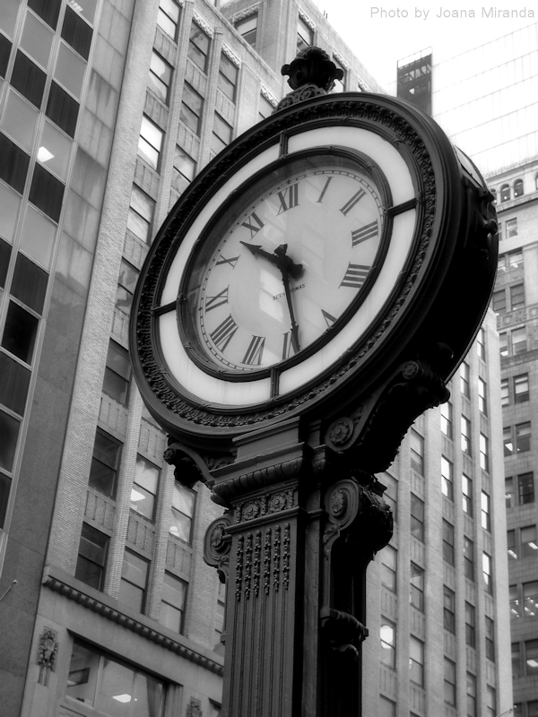 Black and white photo of large clock in Manhattan