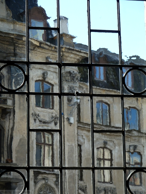 Photo of building seen through church window in Copenhagen, Denmark.
