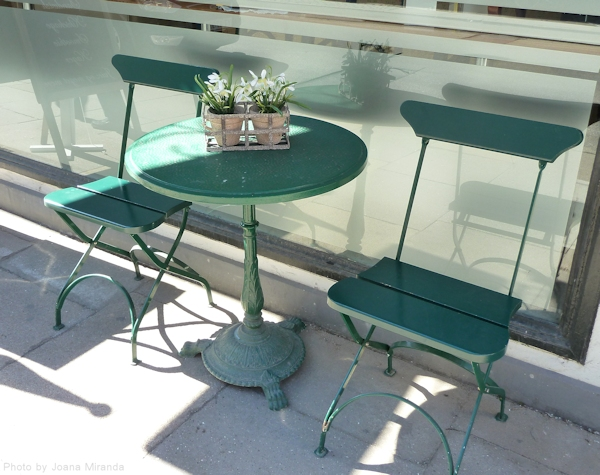 Green table and two patio chairs in Copenhagen, Denmark
