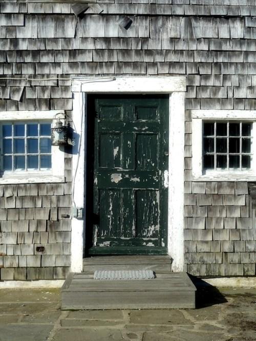 Green weathered door in Nantucket
