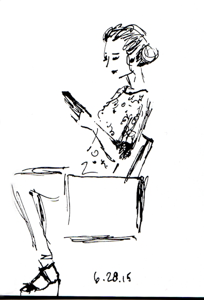 woman seated waiting for the subway