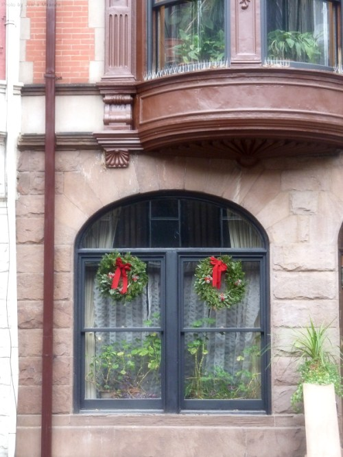 Arched windows in NYC brownstone with holiday wreaths