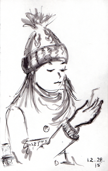 Girl with pom pom hat reading on the subway