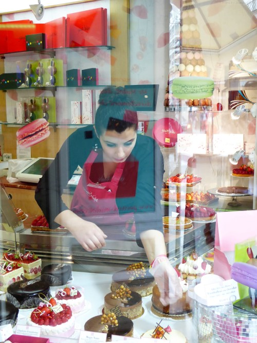 Patisserie window with attendant
