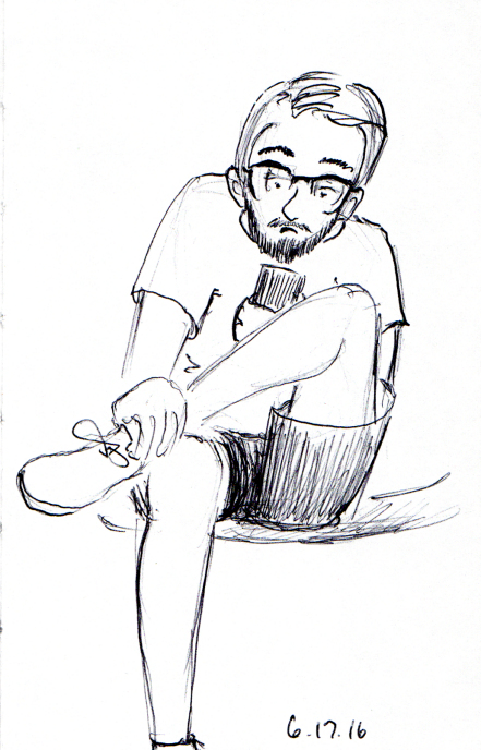 Quick sketch of man at airport gate checking his phone