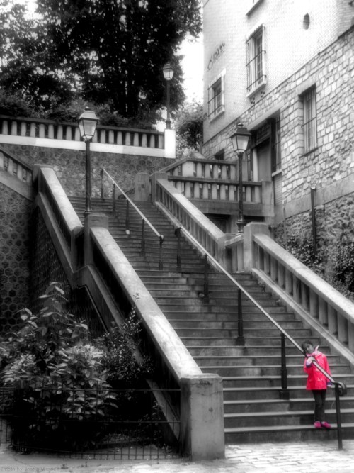 Girl in Red on the stairs in Montmartre