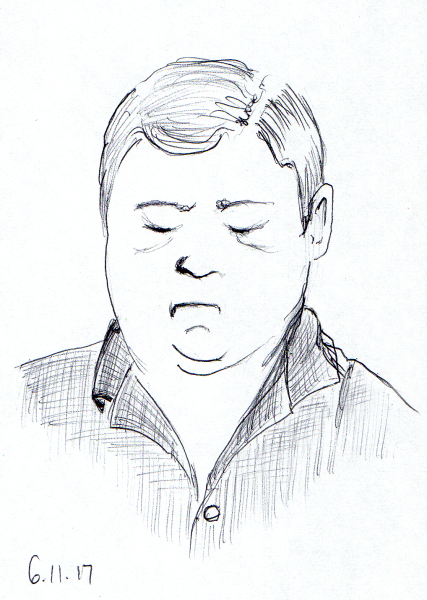 Quick ballpoint pen sketch of man on the Acela train from D.C., by Joana Miranda