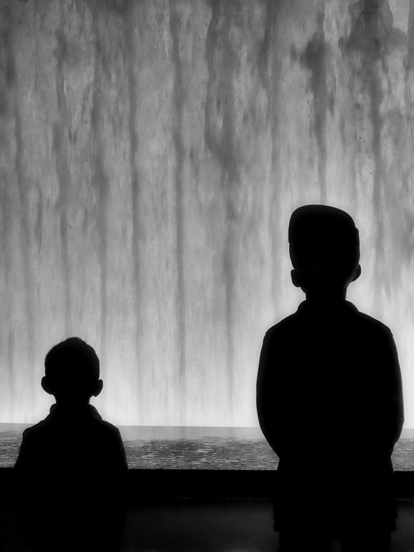 Photo of two young boys looking at the fountain at Lincoln Center, taken by Joana Miranda