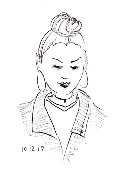 Quick ballpoint pen sketch of woman with top knot hairstyle by Joana Miranda