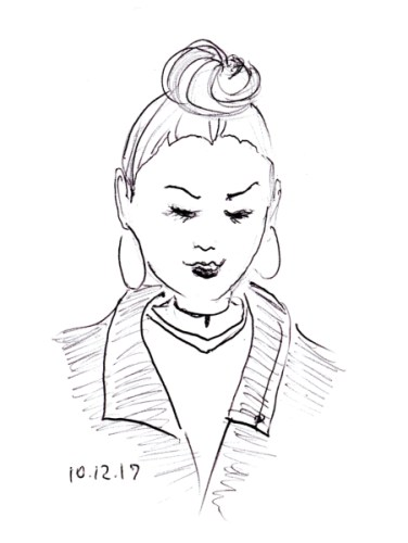 Quick pen sketch of woman with hoop earrings and a top knot hairstyle, by Joana Miranda