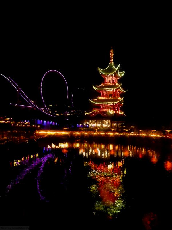 Tivoli Gardens lagoon, pagoda and roller coaster