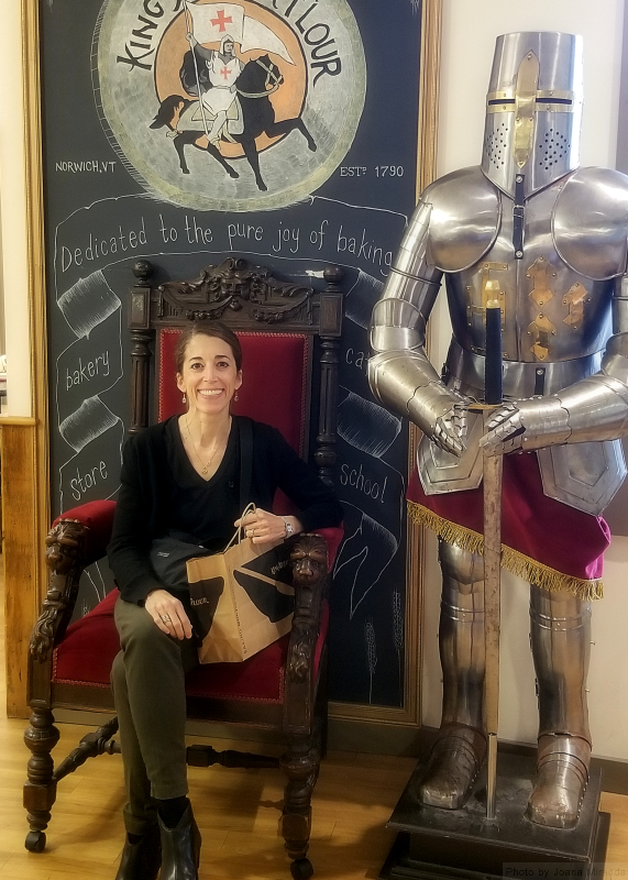 Photo of Joana with the King Arthur suit of armor at the King Arthur Flour store.