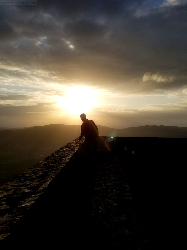 Photo of the sunset over the castle walls of Marvao, Portugal