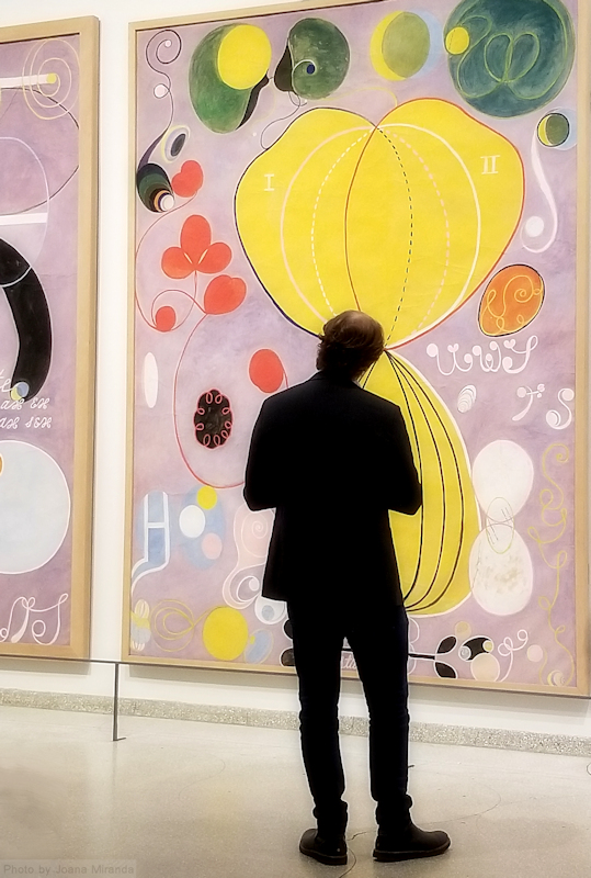 Man looking at Hilma af Klimt painting at the Guggenheim Museum