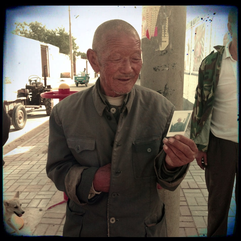 An old villager sees himself for the first time on film - image shot by director Joanna Bowers whilst filming in China