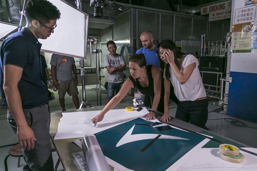Joanna Bowers directs talent on set shooting for Cathay Pacific livery film