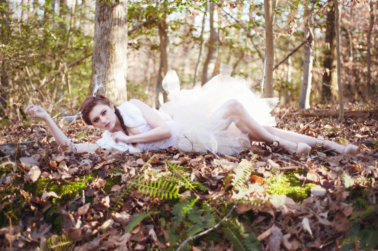woman-in-woods-deer-editorial