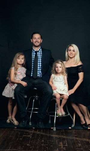 portrait of parents and their daughters in a photo studio