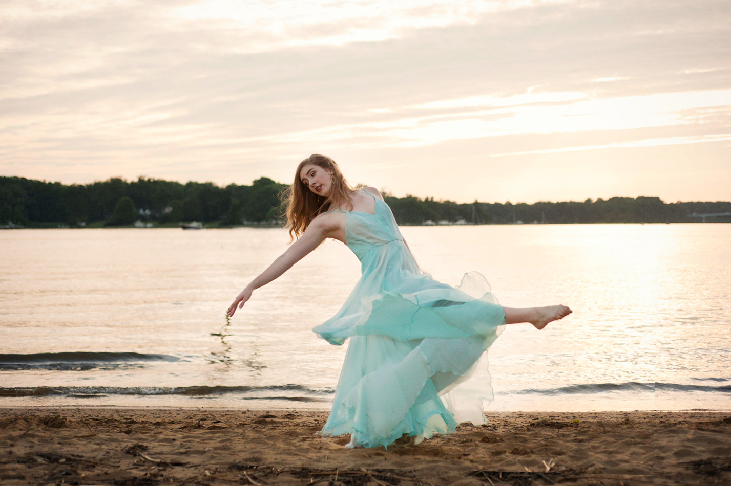 senior picture of girl on beach dancing