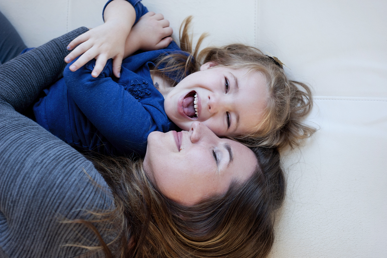 picture of little girl laughing with her mom