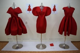 Aneta Jarmoliková designs these red dresses in order to reflect traditions of South Moravia, where is full of joy, abundance, optimistic and friendly atmosphere; and folklore and dance live. Red colour is the traditional colour of the folklore costumes and represents youth.