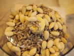 In a food processor grind the almonds and sunflowers until they are course