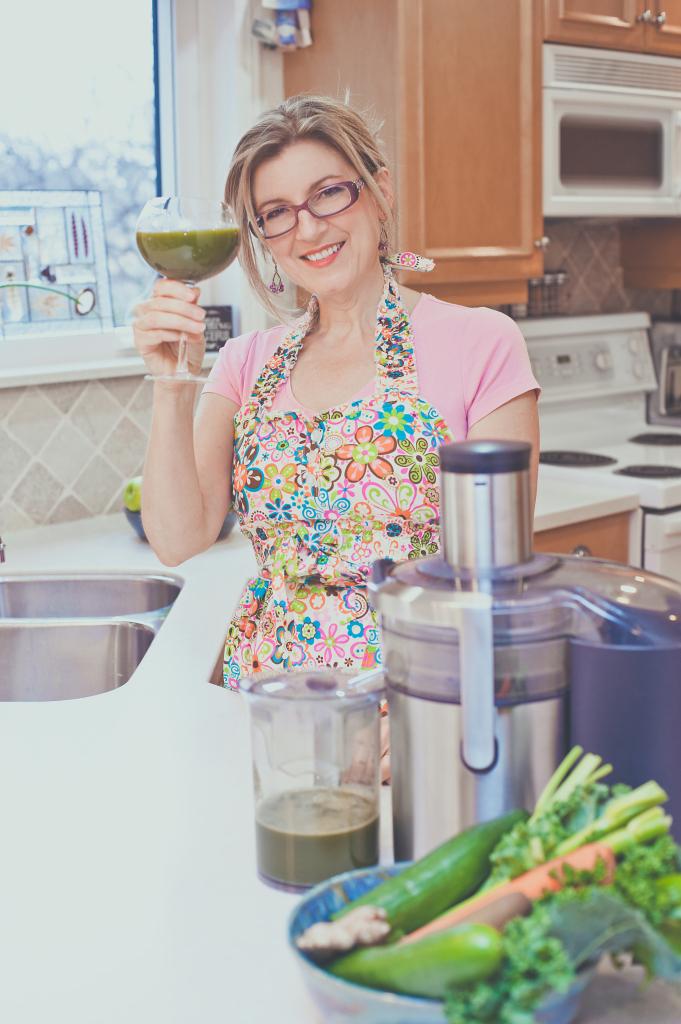 Jo-Ann Blondin In the 9 Cup Kitchen Toasting Green Juice- Copyright Jo-Ann Blondin 2013