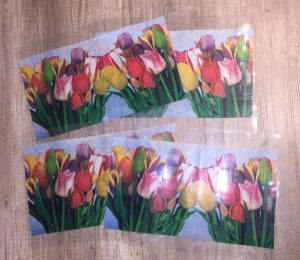 4 laminated pouches with spring napkins to create laminated lamps