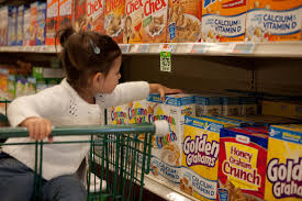 Kid reaching for sugar cereal that marketers target