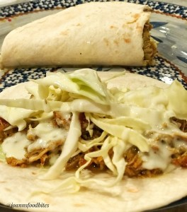 Queso cheese dip on top of cabbage of Asian-Mexican Fusion Chicken Tortilla