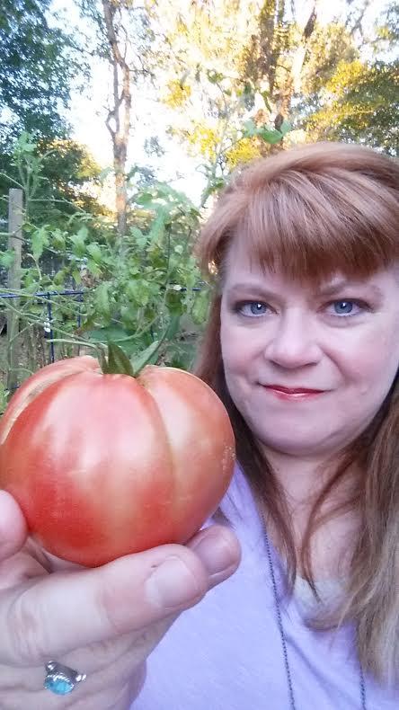 JoAnn's Food Bites holding a tomato