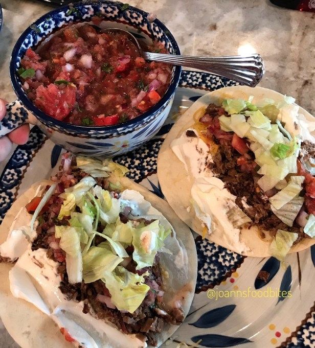 two brisket tacos and homemade salsa
