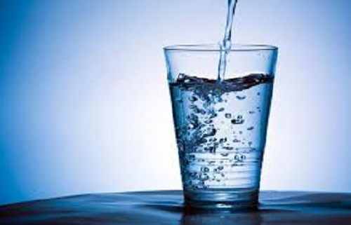 glass of water with a blue background