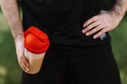 man with a whey protein shake