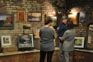 ArtWalk participants enjoy artist Joan Pechanec's show at the Dunsmuir ArtWalk, October 10, 2014
