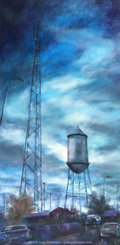 Somewhere in Texas, Original Oil Painting by Joan Pechanec, 12 x 24 For three winters we have made the long drive from California to Alabama. This painting is from a photo taken from our car on the seemingly endless stretch of Highway 10 through Texas. We passed many isolated small towns with their ubiquitous water towers. I tried to convey the lonely, lost-in-another-time feeling these places evoke. I always wonder what it would be like to live in such a town.